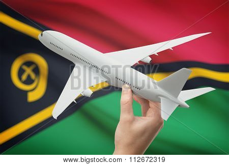 Airplane In Hand With Flag On Background - Vanuatu