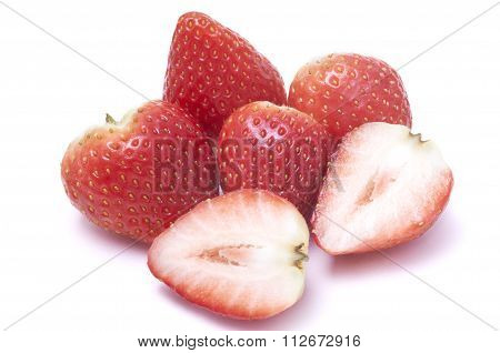 Sliced strawberry and piled strawberries without stalk