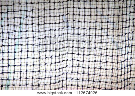 Blurred image of nylon nets at gymnasium, close up.