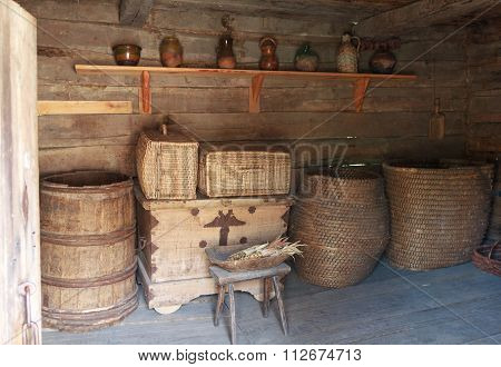 Chests, Barrels And A Shelf With Dishes In The Ancient Peasant Hut. Pirogovo, Ukraine