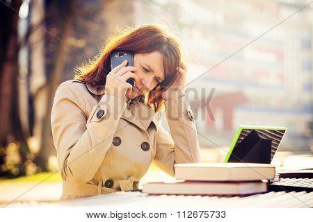 Depressed Young woman getting bad news by phone