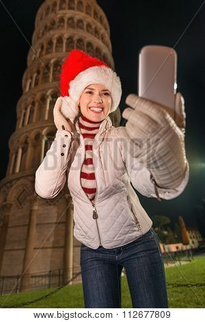 Happy Woman In Santa Hat Taking Selfie Near Leaning Tower, Pisa