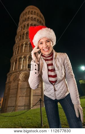 Woman In Santa Hat Talking Mobile Phone Near Leaning Tower, Pisa