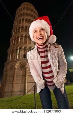 Smiling Woman In Santa Hat Looking Up Near Leaning Tower Of Pisa