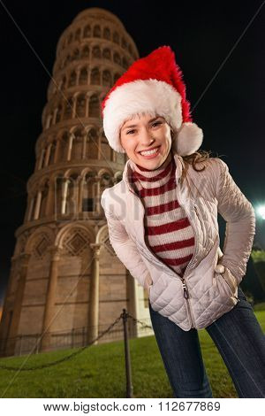 Portrait Of Smiling Woman In Santa Hat Near Leaning Tower, Pisa