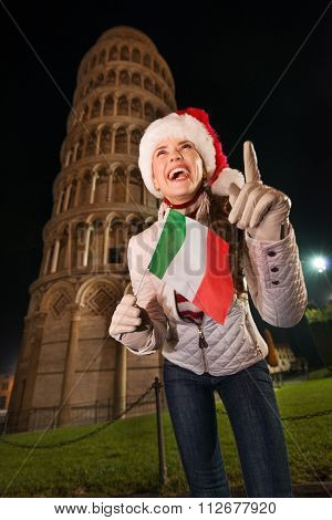 Woman In Santa Hat With Italian Flag Pointing Up. Pisa, Italy