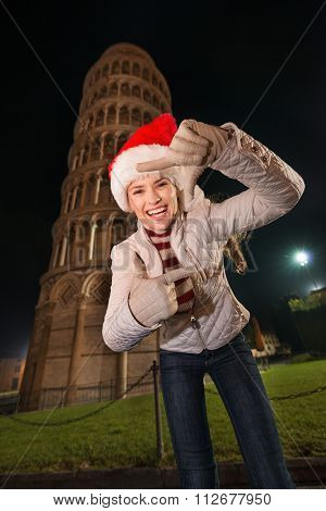 Woman In Santa Hat Framing With Hands Near Leaning Tower Of Pisa