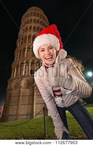 Woman In Santa Hat Showing Thumbs Up Near Leaning Tower Of Pisa