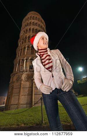 Woman In Santa Hat Looking On Something Near Leaning Tower, Pisa