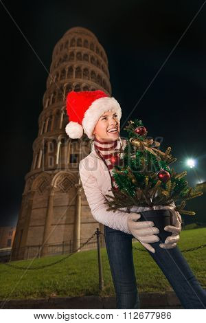 Woman In Santa Hat With Christmas Tree Near Leaning Tower, Pisa