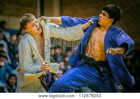 young judoists during fight hold each other for kimono