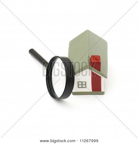 magnifying glass examining model home