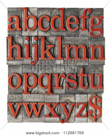 English alphabet (lowercase) and dollar sign in vintage grunge letterpress metal type stained by red ink