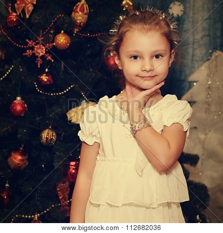 Beautiful Cute Kid Girl Model Posing In Fashion White Dress And Silver Bangle On Fir Tree Background