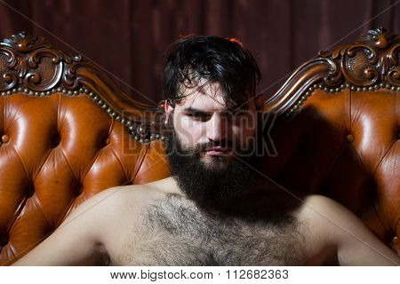 Bearded Naked Man On Couch