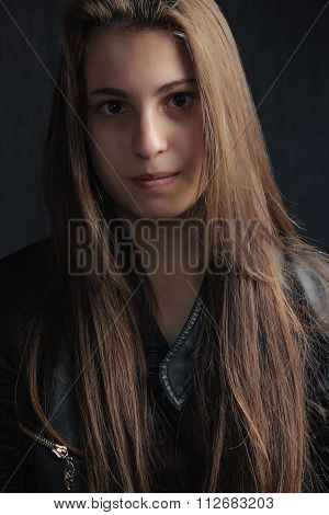portrait of the young nice girl with long hair