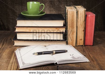 Green Mug On Old Books