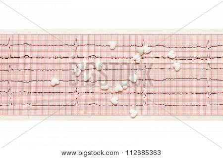 White heart shape tablets on paper ECG results