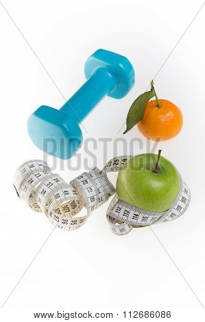 Dumbells With Measuring Tape And Fruits On Color Background
