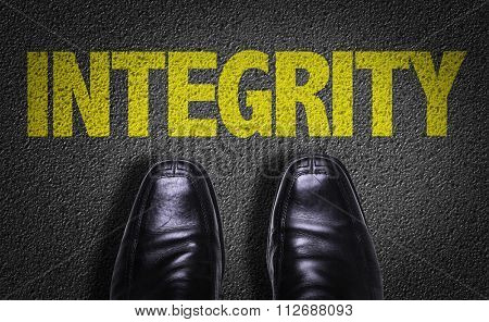 Top View of Business Shoes on the floor with the text: Integrity
