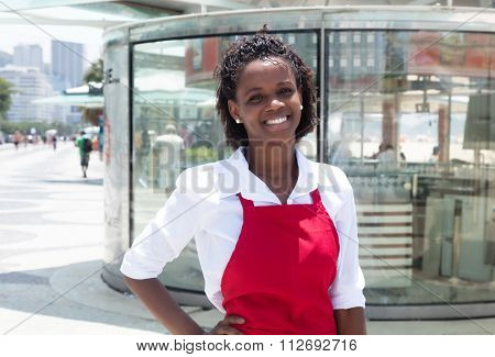 Happy African American Waitress In Front Of The Restaurant