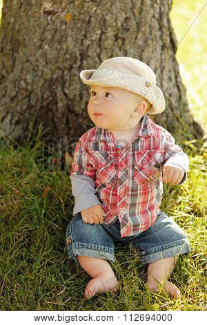 Little Boy Playing In A Cowboy Hat On Nature
