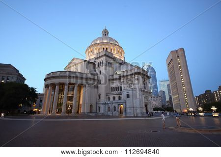 USA, BOSTON - SEP 06, 2014: Mary Baker Eddy Library and Christian Science Mother Church near pond at autumn evening.