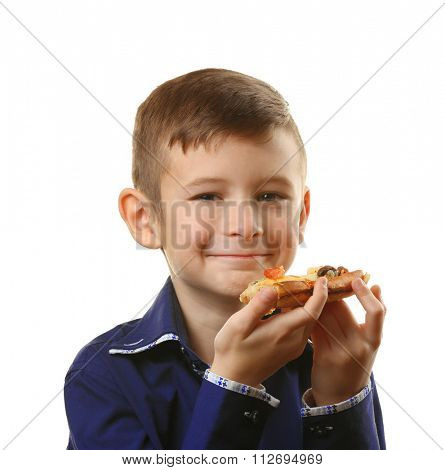 Little boy eating pizza isolated on white