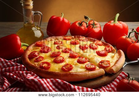 Pizza Margherita, removed slice and vegetables, close-up