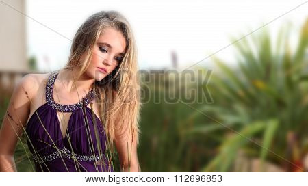 Sultry Looking Blonde Lady In Garden