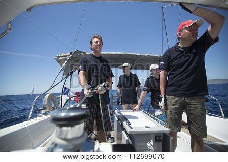 SYROS-KYTHNOS, GREECE - CIRCA MAY, 2014: Sailors participate in sailing regatta 11th Ellada 2014 among Greek island group in the Aegean Sea, in Cyclades and Argo-Saronic Gulf.