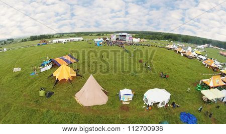 RUSSIA, BOROVSK - JUN 13, 2014: Aerial view of the many colored different tents on field at ethnofestival Wild mint.