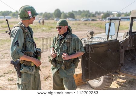 NELIDOVO, RUSSIA- JULY 12, 2014: Battlefield 2014: Two US soldiers standing near the car