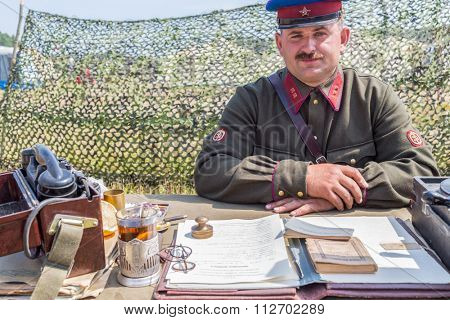 NELIDOVO, RUSSIA- JULY 12, 2014: Battlefield 2014: lieutenant of the Red Army at the desk