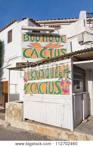 Cactus Boutique Creative Sign On White Building