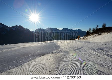 The Ski Slope With A View On Dolomiti Mountains And Sun, Madonna Di Campiglio, Italy