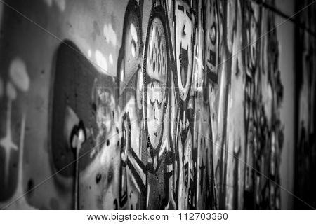 black ink grafitti design in city wall, street art segment