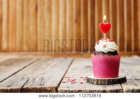 Cupcake With Cream Cheese Frosting And Heart Sprinkles And The Candle For Valentines Day