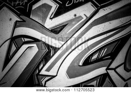 black ink grafitti design in city wall, street art segment