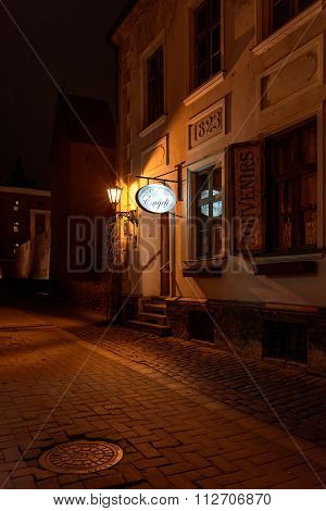 RIGA, LATVIA - DECEMBER 2015: Entrance to souvenir shop in old town of Riga city in Latvia.
