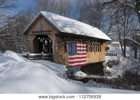 Snow Covered Bridge With American Flag