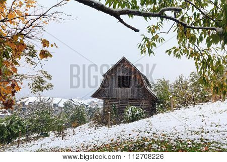 Wooden Hut And A Snowstorm In The Mountains. Carpathians