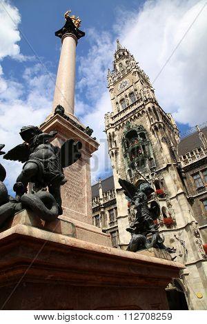 The Golden Statue Of Mary (mariensaule), A Marian Column On The Marienplatz In Munich, German