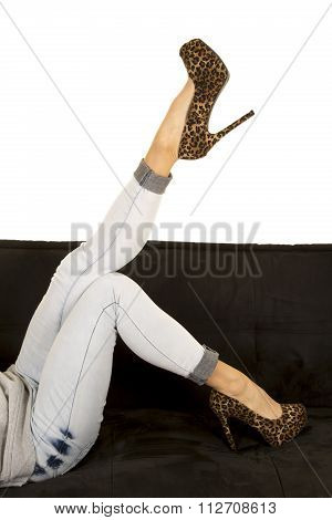 Woman Legs In Denim And Heels Lay One Leg Up