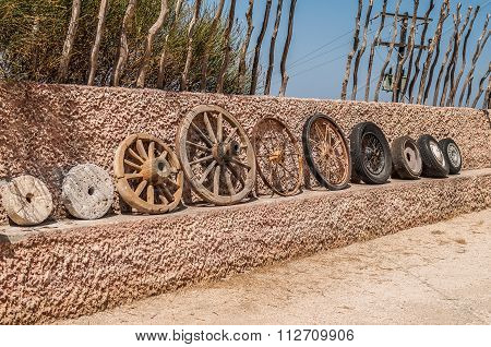 The evolution of the wheel starting from a stone wheel and ending with a steel-belted radial tire.