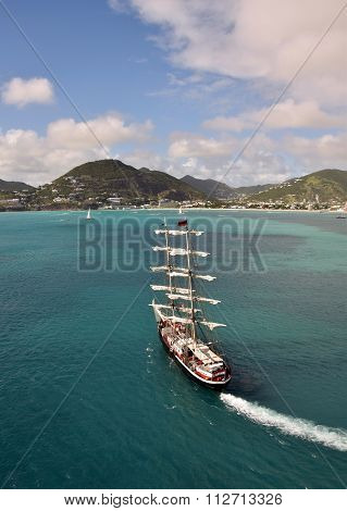 PHILIPSBURG, ST MARTIN - DECEMBER 23: Sailing ship approaches the island of Saint Martin in the Caribbean on December 23, 2014