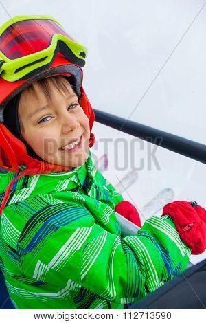 Little skier on ski lift