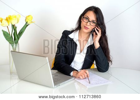 business woman at work using phone