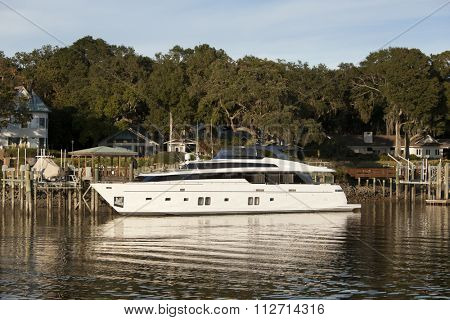 Private yacht docked outside expensive home in South Carolina