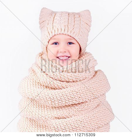 Happy Boy Covered In Volume Knitted Scarf And Hat